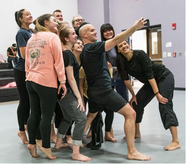 UA students taking a selfie with choreographer Brian Brooks (NYC).